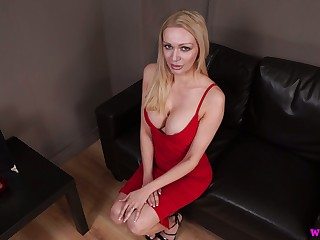 Lady in red Amber Jayne jerks off dick and takes cumshots on her fake boobs