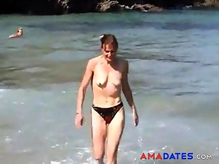 girl topless on beach with closely-knit empty saggy jugs