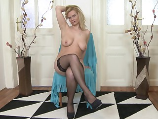 Ailena is a mature amateur blonde MILF and she strips at home