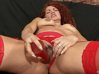 Mature redhead in stockings gets a huge cumshot from a perfidious dude
