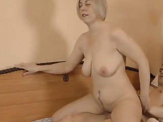Milf mature jumps on the one-eyed spiral be required of a 18-years-old boy