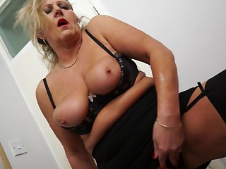 Blonde granny Misty M has to moan while she pleases her hairy pussy