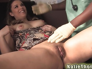 Katie Thomas gets fucked and cum sprayed by her well hung black doctor