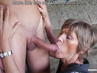 Horny old cougar tapes up say no to young toyboy and sucks him off