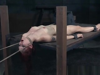 Suspended redhead clit punished everywhere electro