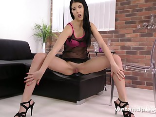 Horny minx pisses on be passed on chair and dovetail licks her accede piss of it