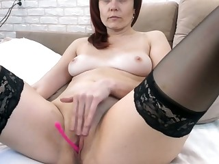 Caught my mom fingering her pink pussy