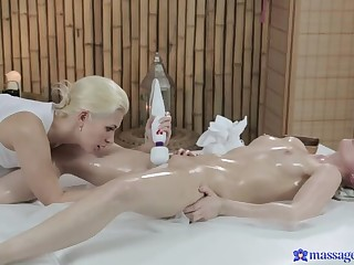 Two Gorgeous Blondes Rub Each Other's Confidential In Oil