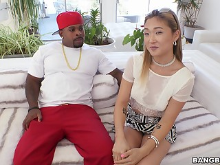 Hot Asian Nyomi Star offers up her tight ass to a black stud
